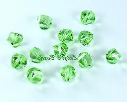 12 Peridot Swarovski #5020 Helix Beads 6mm