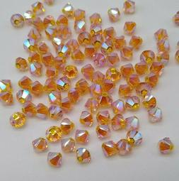 24pc Swarovski Crystal Sunflower AB2X 4mm Bicone Beads; Auro