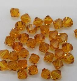 48pc Swarovski Crystal Topaz 5mm Bicone 5328 Beads; Wholesal