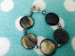 Bracelet features Gray and Brown Pearly Glass Disc Beads