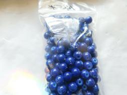 Dark blue 6mm opaque beads with light blue splatter