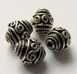 Medium Oxidized Bali-Style Sterling Silver Oval Bead w/ Scro
