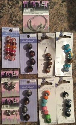 Nine New Packages Of Beads And A Metal Bracelet
