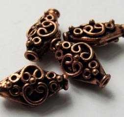 Solid copper antiqued Bali-style diamond beads - 16x10 mm -